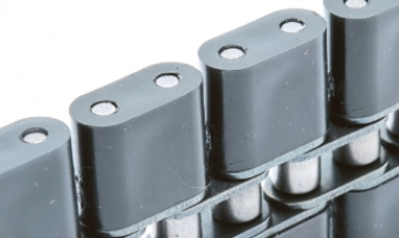 Roller chains with plastic parts